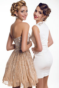 two beautiful young girls in elegant dresses